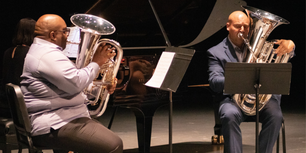 black male playing euphonium brass and white male playing tuba