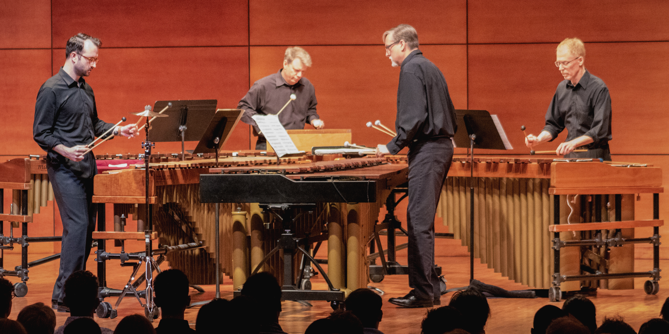Musicians playing marimba and percussion instruments