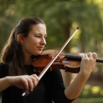 young white female outside playing violin