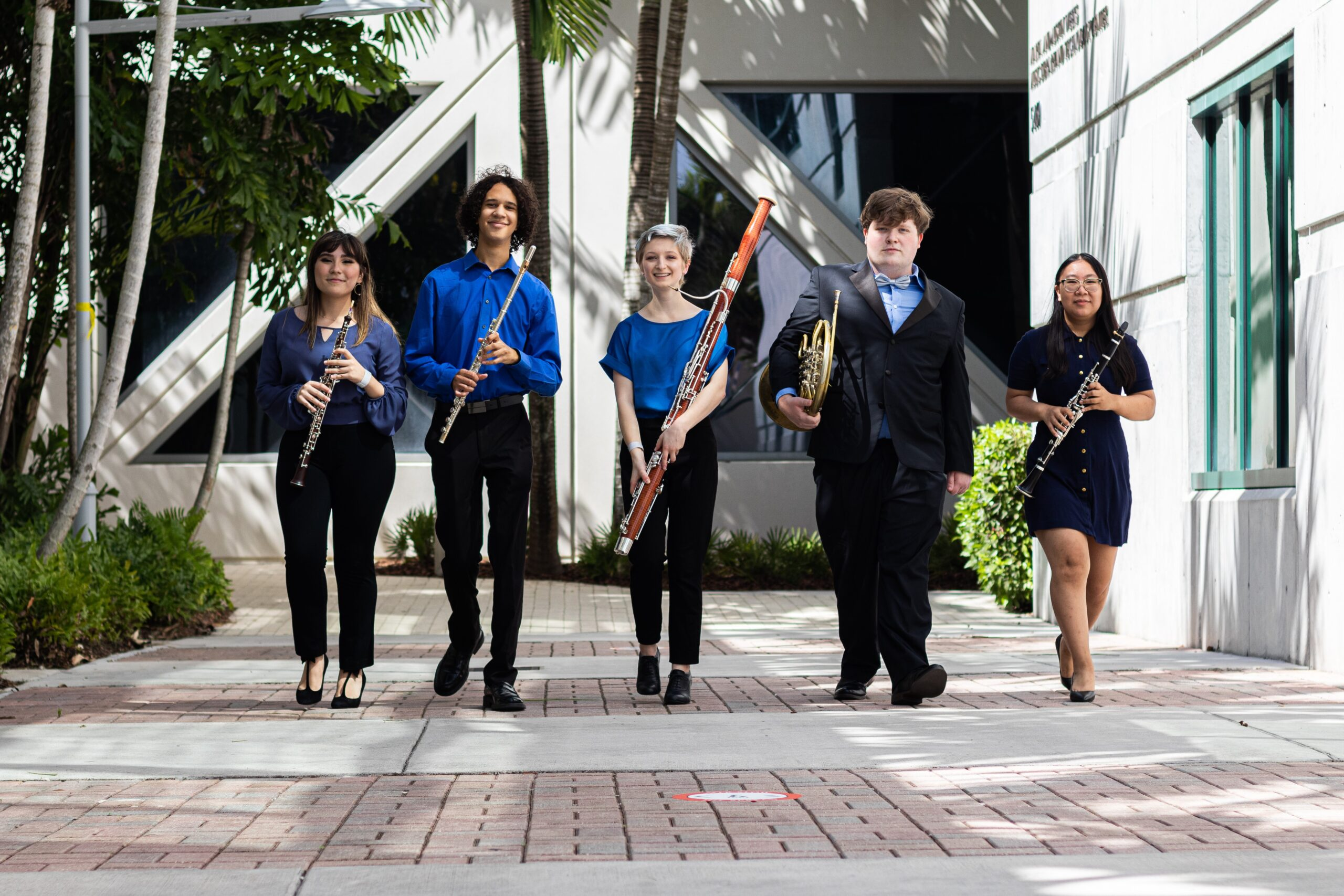 five young musicians holding woodwinds instruments