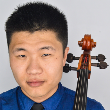 asian male in blue shirt holding cello