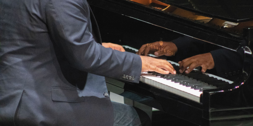 male black hands playing on piano kets