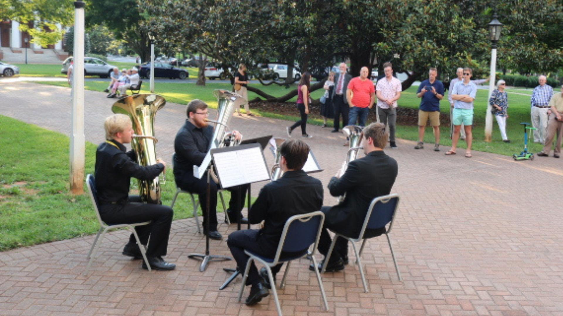brass quartet playing outside