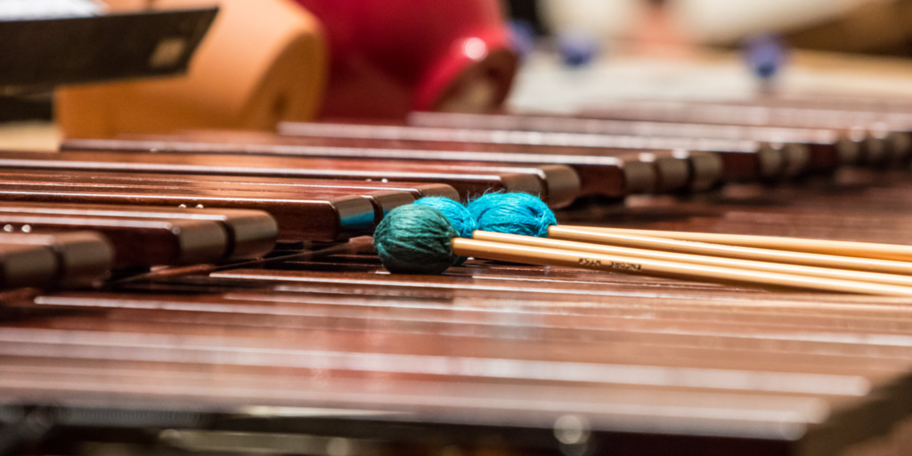 wooden marimba with teal mallets