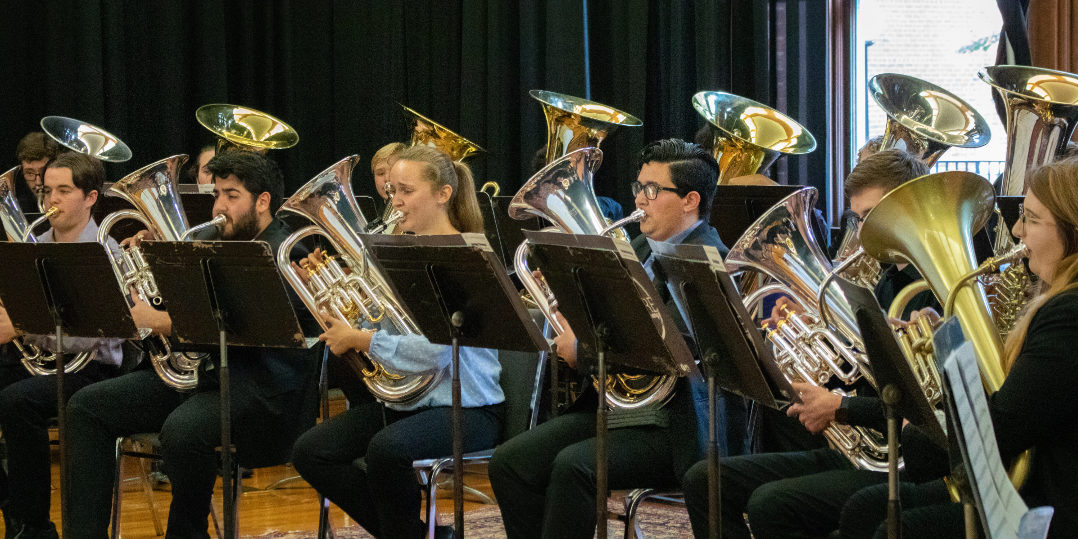 musicians playing euphoniums and tubas