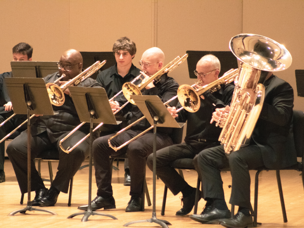 musicians playing trombone and a tuba dressed in black