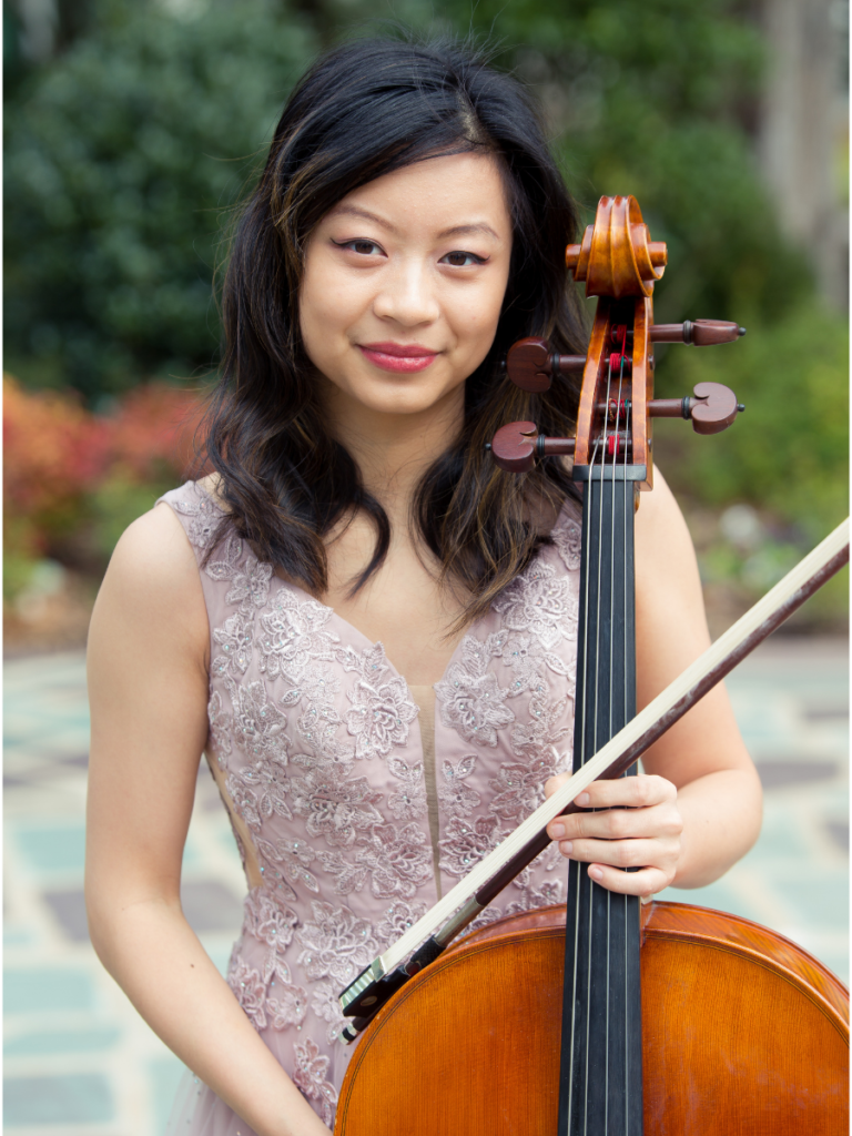 asian American woman in a fancy lilac gown holding cello instrument and bow